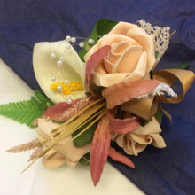corsage of nerine, calla and roses