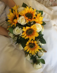 A wedding collection of artificial ivory roses and sunflowers