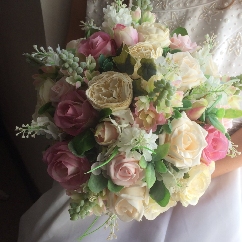 A bouquet collection of pink & cream stocks, roses & ranunculus