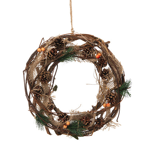artificial christmas wreath with pine cones and berries