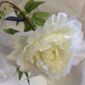 an artificial cream peony silk flower