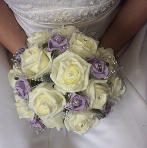 brides bouquet of lilac and ivory roses, pearls and diamante
