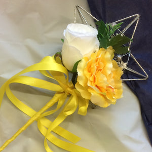 A bridesmaids star wand with white rose & yellow carnation