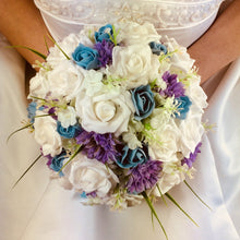 wedding bouquet of artificial blue and lilac flowers