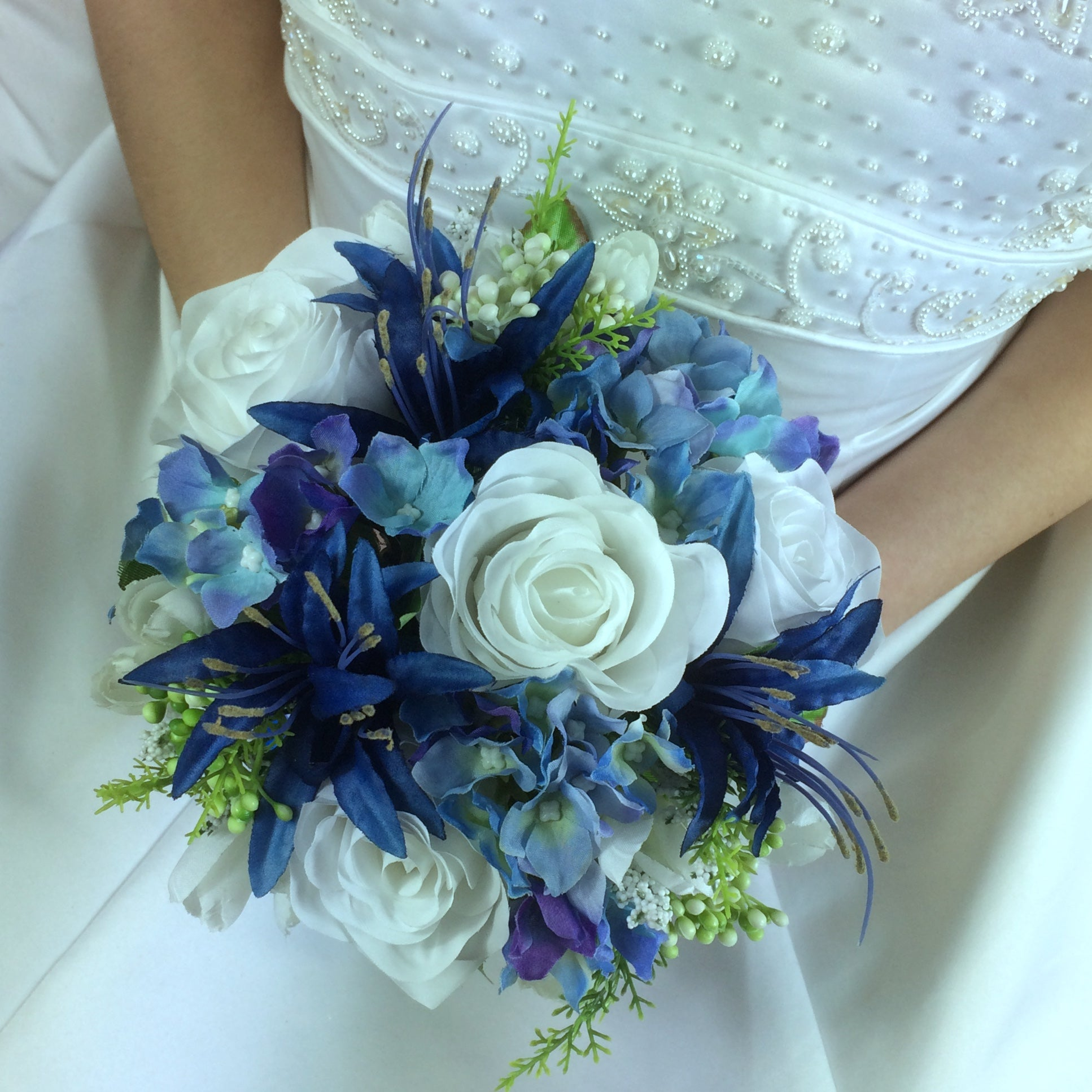 A Bridesmaids Bouquet Of Blue White Or Ivory Silk Flowers