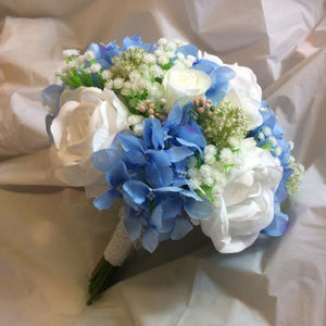 wedding bouquet of white and blue roses and hydrangea