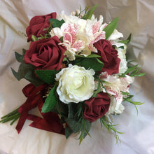 burgundy and ivory roses feature in this wedding bouquet