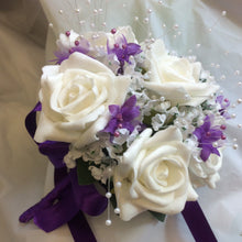 Ivory and purple bridesmaids wedding bouquet