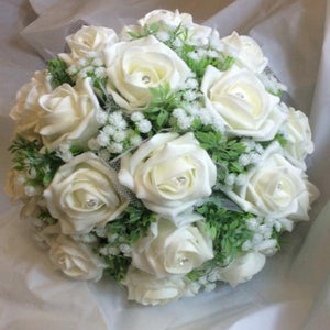 A wedding bouquet collection featuring ivory foam roses and gyp