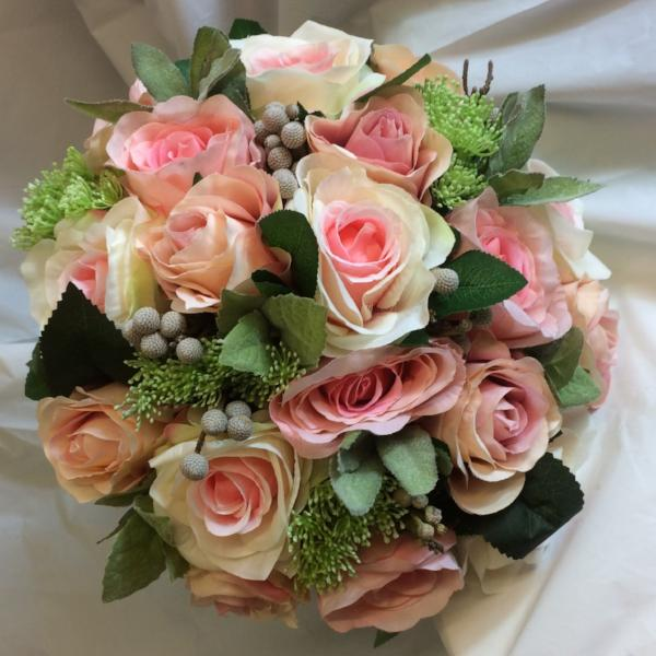 brides bouquet of pink and apricot roses