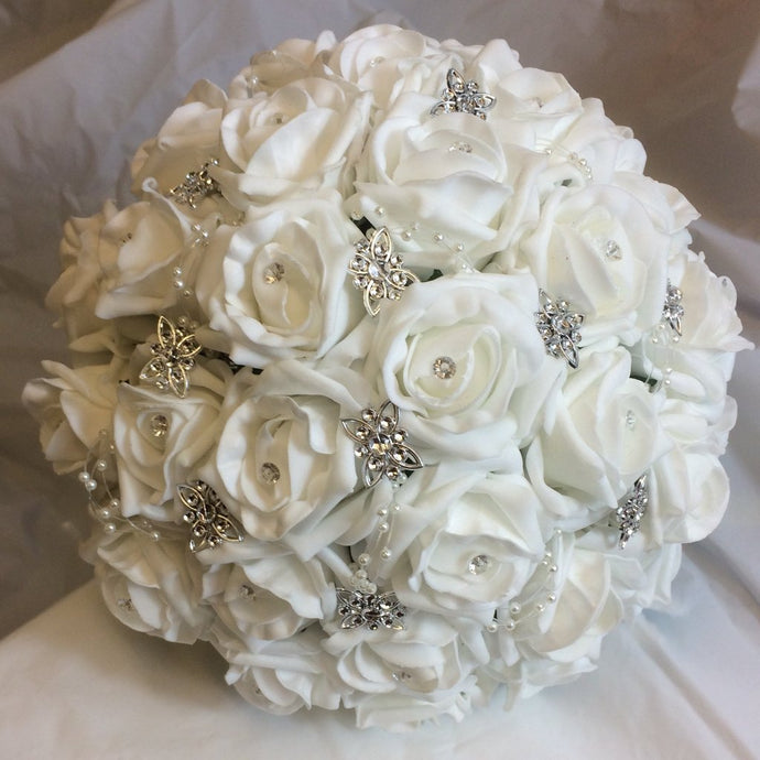 brides bouquet of white foam roses and silver emblishments
