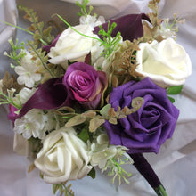 bridesmaids bouquet of aubergine calla lilies, roses and fern
