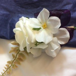 ivory and aubergine buttonhole