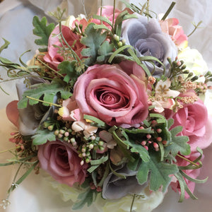 an artificial silk brides wedding bouquet in shades of lilac/grey and pink