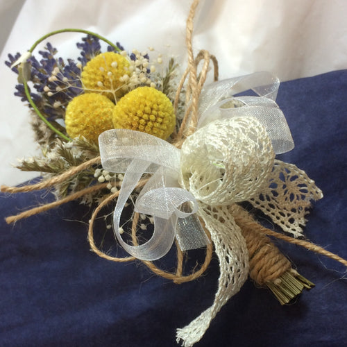 buttonhole of dried lavender and billy buttons
