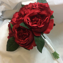 - A brides bouquet featuring artificial silk red David Austin roses