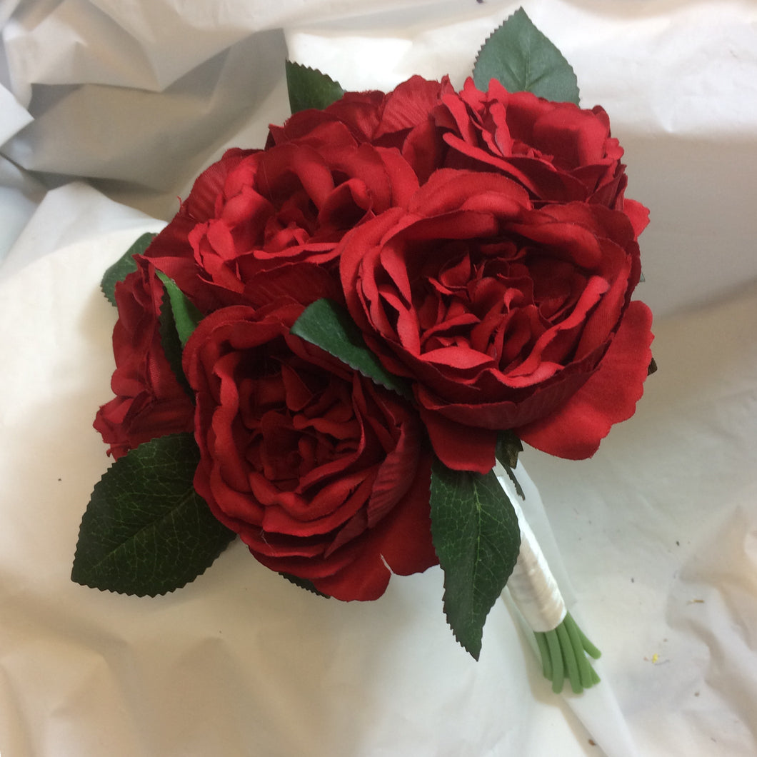 wedding bouquet of large red david austin silk roses