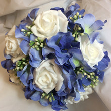 - A bridal bouquet collection of white or ivory roses plus blue artificial silk hydrangea