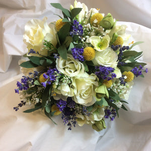 a wedding bouquet of silk and dried flowers