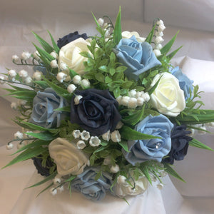 brides bouquet featuring roam roses and lily of the valley