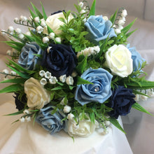 blue foam roses and lily of the valley feature in this wedding bouquet