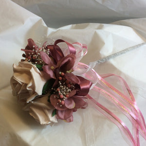 a bridesmaids flower wand with mocha pink roses and dusky pink hydrangea