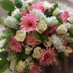 ivory and pink roses and gerbera top table arrangement