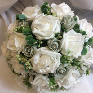 - a wedding bouquet collection of white or ivory foam roses and foliage