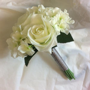 - A wedding bouquet collection of artificial silk ivory flowers