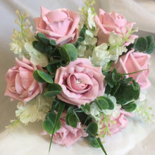 flower girls posy of pink foam roses