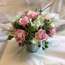 A flower arrangement featuring artificial foam roses -choice of rose colour