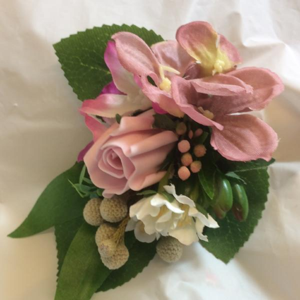 corsage of dusky pink flowers