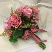 A wedding bouquet colllection of dusky pink roses, hydrangea and orchids