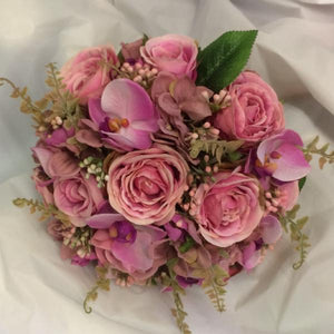 dusky pink brides wedding bouquet of artificial flowers