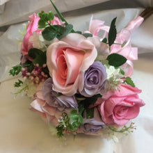 - A brides or adult bridesmaids hand-tied bouquet of silk pink & lilac roses