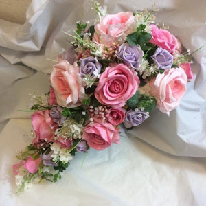 teardrop wedding bouquet of pink and lilac silk flowers
