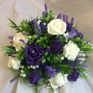 purple and ivory foam roses arrange in a green o'bowl