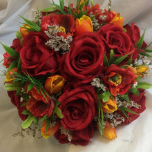 a brides bouquet of red roses, poppies and tulips