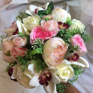 brides bouquet of orchids, peonies and roses