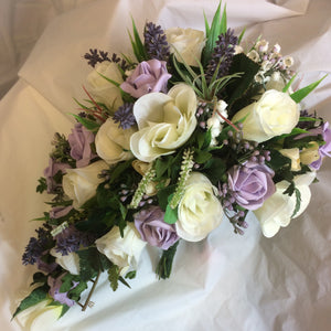 teardrop brides bouquet of lavender and ivory flowers