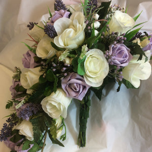 A teardrop bouquet of ivory and lilac artificial roses