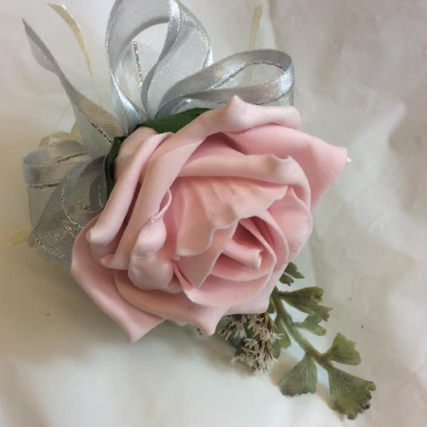 a pale pink rose buttonhole and silver grey foliage