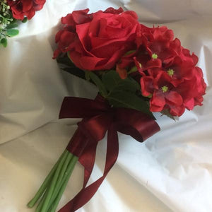 bridesmaids wedding bouquet of red artificial flowers