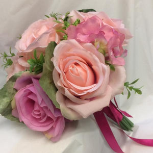 A bridesmaid bouquet of artificial silk pink roses & hydrangea flowers