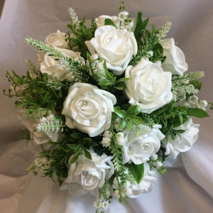 a wedding bouquet collection of white or ivory roses & lily of the valley