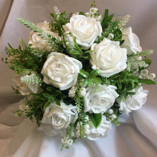 white or ivory wedding bouquet of foam roses, gyp and foliage