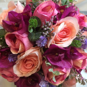 A wedding bouquet of pink and lilac artificial silk flowers