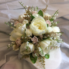 a brides bouquet of artificial silk ivory and dusky pink peony & roses