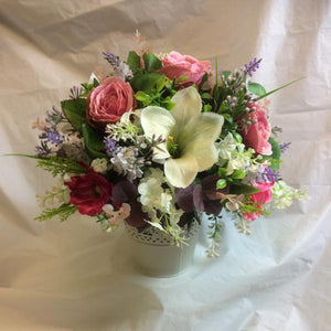 artificial flower arrangement in shades of pink and ivory