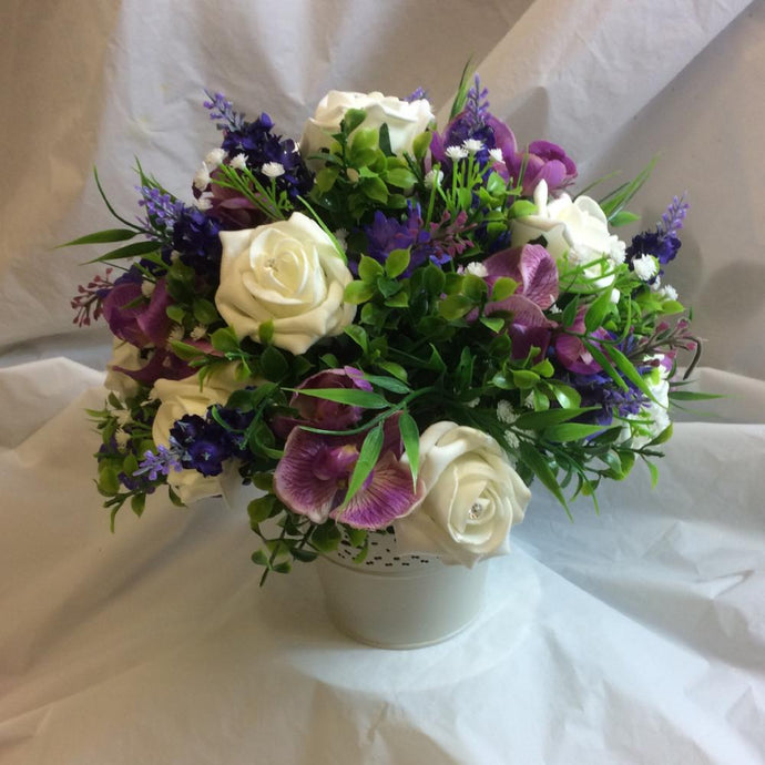 lilac mauve and ivory artificial flower table centre